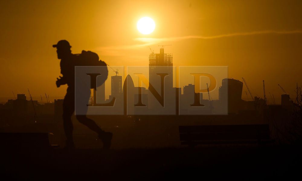 © Licensed to London News Pictures. 16/12/2018. London, UK. The sun rises over the City of London, seen from Parliament hill on Hampstead Heath, on a cold winter morning.  Large parts of the UK have experienced snowfall as storm Deidre brings freezing temperatures. Photo credit: Ben Cawthra/LNP