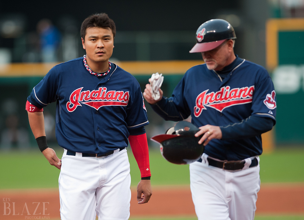 CLEVELAND, OH USA - MAY 8:  Cleveland Indians right fielder Shin-Soo Choo (17) walks off the field with Cleveland Indians third base coach Steve Smith (10) during the second inning against the Chicago White Sox at Progressive Field in Cleveland, OH, USA on Tuesday, May 8, 2012.