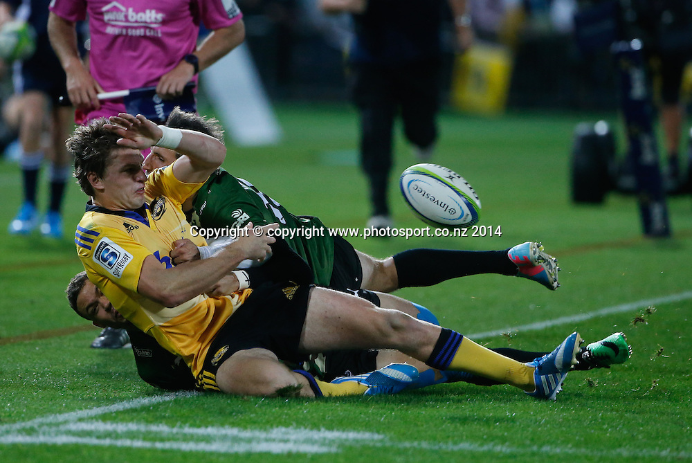 Hurricane's Beauden Barrett passes in the tackle during the Super Rugby match, Hurricanes v Bulls, McLean Park, Napier, New Zealand. Saturday, 05 April, 2014. Photo: John Cowpland / photosport.co.nz