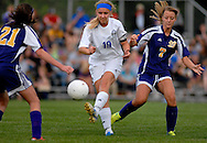 11 MAY 2012 -- ALTON, Ill. -- Alton Marquette High School soccer player Cassie McFadden (19) pushes the ball between Civic Memorial High School's Mackenzie Perkins (7) and Kara Wesolowski (21) during the Class 1A Regional Finals at Gordon Moore Park in Alton Friday, May 11, 2012. Photo © copyright 2012 Sid Hastings.