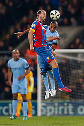 Glenn Murray of Crystal Palace and Fernandinho of Manchester City compete in the air - Photo mandatory by-line: Rogan Thomson/JMP - 07966 386802 - 06/04/2015 - SPORT - FOOTBALL - London, England - Selhurst Park - Crystal Palace v Manchester City - Barclays Premier League.