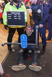 © Licensed to London News Pictures . 08/12/2012 . Manchester , UK . Police detain a protester after a number forced their way in to the branch . UKUncut hold a demonstration against corporate tax avoidance outside a branch of Starbucks on St Ann's Square in Manchester City Centre today (8th December 2012) . Photo credit : Joel Goodman/LNP