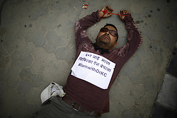 August 15, 2017 - Kathmandu, Nepal - An activist lies on the ground while staging a demonstration to save the life of Dr. Govinda KC who is in hunger strike for the last 23 days for the 11th time demanding reforms in medical education sector in Kathmandu, Nepal on Tuesday, August 15, 2017. (Credit Image: © Skanda Gautam via ZUMA Wire)
