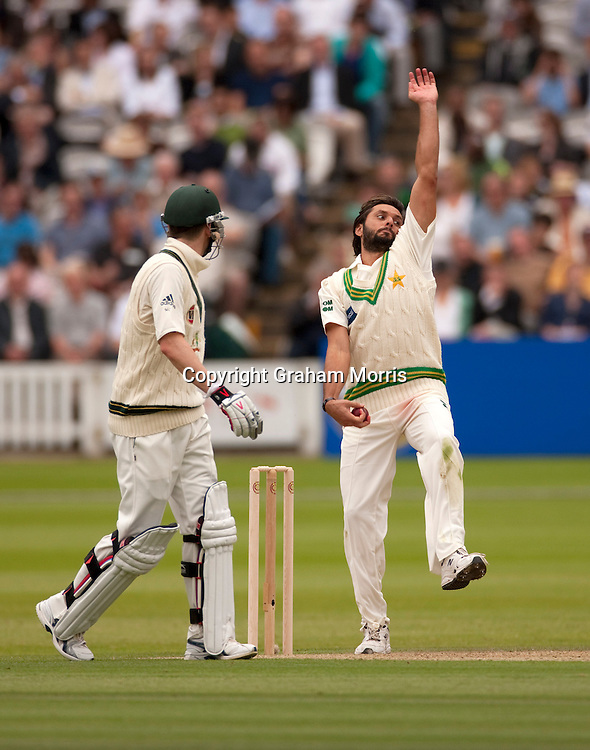 Captain Shahid Afridi bowls past Michael Clarke during the MCC Spirit of Cricket Test Match between Pakistan and Australia at Lord's.  Photo: Graham Morris (Tel: +44(0)20 8969 4192 Email: sales@cricketpix.com) 13/07/10