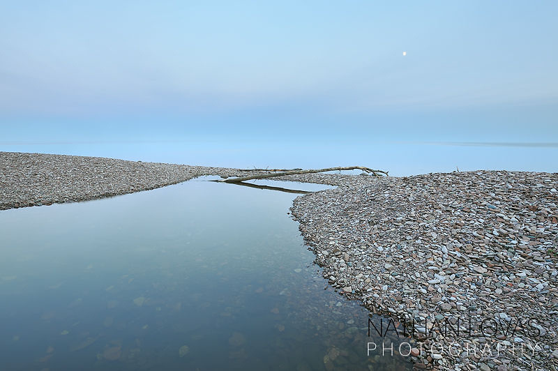 River flowing into Lake Superior on rocky beach;  North Shore, Minnesota.