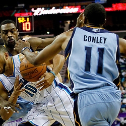 April 15, 2012; New Orleans, LA, USA; New Orleans Hornets shooting guard Eric Gordon (10) is defended by Memphis Grizzlies point guard Mike Conley (11) and shooting guard Tony Allen (9) during the second quarter of a game at the New Orleans Arena. The Hornets defeated the Grizzlies 88-75.  Mandatory Credit: Derick E. Hingle-US PRESSWIRE