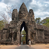 "Angkor Thom was the capital of the Khmer empire until 1295. Today the south gate is the main entrance for tourists. The Angkor Thom complex was featured in the ""Lara Croft"" movie ""Tomb Raider"", starring by Angelina Jolie."