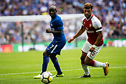 Arsenal midfielder Alex Oxlade-Chamberlain (15), Chelsea (7) N'Golo Kanté during the FA Community Shield match between Arsenal and Chelsea at Wembley Stadium, London, England on 6 August 2017. Photo by Sebastian Frej.