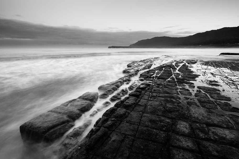 The geological formation known as the Tessallated Pavement near Eaglehawk Neck on the Tasman Peninsula at sunset.