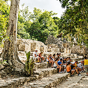A group of school students listens to a guide while sitting on the lower steps of the temple structure known as La Iglesia at the Mayan site of Coba on Mexico's Yucatan Peninsula. At its height, Coba is estimated to have had about 50,000 inhabitants. at Coba, an expansive Mayan site on Mexico's Yucatan Peninsula not far from the more famous Tulum ruins. Nestled between two lakes, Coba is estimated to have been home to at least 50,000 residents at its pre-Colombian peak.