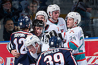 KELOWNA, CANADA - JANUARY 22: Dustin Minty, linesman, gets caught up between the Kelowna Rockets and the Tri City Americans on January 22, 2016 at Prospera Place in Kelowna, British Columbia, Canada.  (Photo by Marissa Baecker/Shoot the Breeze)  *** Local Caption *** Dustin Minty;