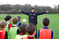 CARDIFF, WALES - Thursday, January 31, 2013: Wales' manager Chris Coleman coaches children at the launch of Vauxhall's Fun Football programme with the Football Association of Wales and the Welsh Football Trust at the Vale of Glamorgan Hotel. For more information please contact Amy White on 07805 936211.  (Pic by David Rawcliffe/Propaganda)