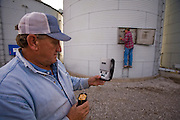 Grain Farmer Gordon Stine tests grain for moisture content at his leased farm in St. Elmo, Illinois.  (Gordon Stine is featured in the book What I Eat; Around the World in 80 Diets.)