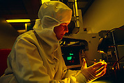 Inspecting micro-chip base boards in the clean room at Balzers, a high-tech vacuum company, Principality of Liechtenstein...