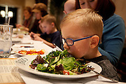 Carter Davidson presses his face into his mother, Sedra's, plate of lettuce during lunch at BRIO Tuscan Grill in Murray, Friday, Nov. 9, 2012.