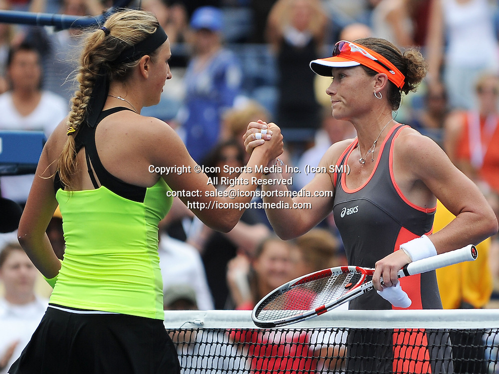 September  04, 2012:  Victoria Azarenka of Bulgaria and Samantha Stosur of Australia shake hands at the net after Azarenka defeated Stosur in the quarter final during the US Open tennis tournament at the Billie Jean King National Tennis Center in Flushing, NY.