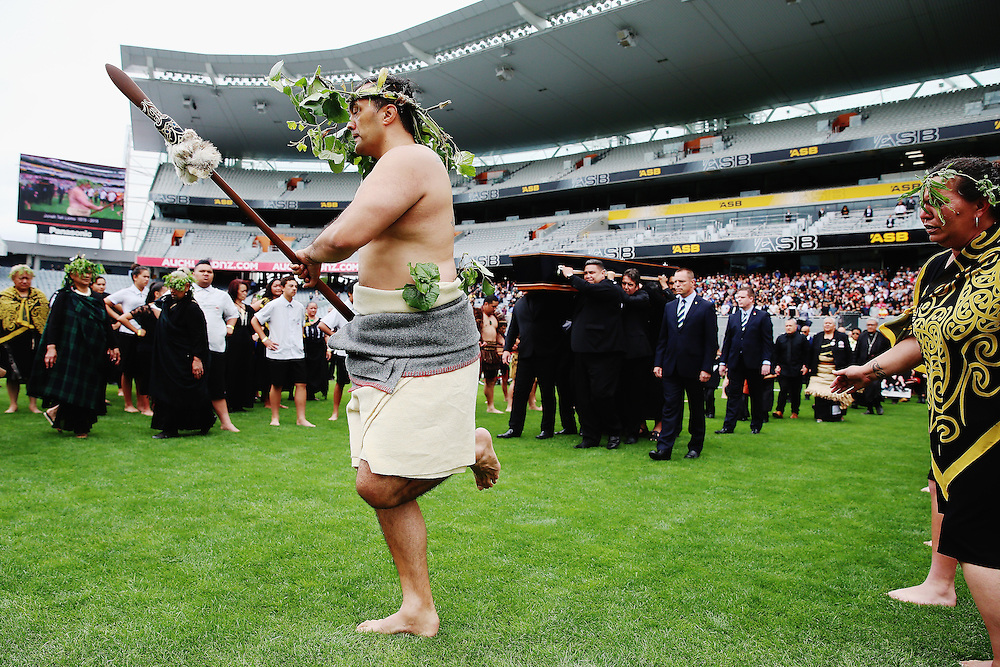 A Maori warrior leads the casket carrying the body of Jonah Lomu is carried onto the field at the Remembering former All Black Jonah Memorial Service, Eden Park,, Auckland New Zealand, Monday, November 30, 2015. Credit:SNPA / Getty, Hannah Peters **POOL**
