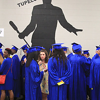 Tupelo Seniors wait backstage before walking out to graduate Friday night at the BancorpSouth Arena.