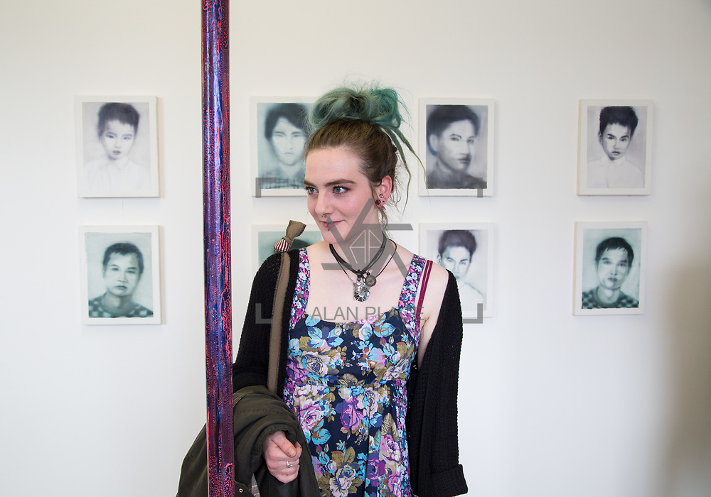 11.06.2017         <br /> International award winning artists are among the almost 200 graduates of Limerick School of Art and Design who's work went on exhibition at the LSAD Graduate Show 2017.<br /> <br /> Pictured is Olivia Robinson admiring the work of 4th year graduating Painting  student, Gary Kin-San Chan, titled 'The Binary Oppositions and The Myth of Sisyphus'.<br />  <br /> Students from the college took control of the over-riding message of this historical show as they conceptualised, designed and delivered on the theme - be.cause.<br />  <br /> The hypothesis conceived by Graphic Design graduates Cassandra Walsh and David Reilly, is derived from the fact the graduates have now reached a stage where they are confident with their work, their interpretations and creative solutions. As creative minds they have an innate need to &ldquo;do&rdquo; something. There is just this need to create, be.cause.<br /> . Picture: Alan Place.