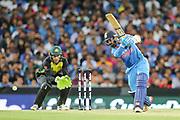 Dinesh Karthik hits through cover. T20 international, Australia v India. Sydney Cricket Ground, NSW, Australia, 25 November 2018. Copyright Image: David Neilson / www.photosport.nz