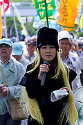 Thousands of people took part in the 88th May Day rally in Central Tokyo to mark International Workers` Day. Tokyo, Japan. Monday, May 1st 2017 The rally started at 9am in Yoyogi Park near Shibuya and the march began at 12:30 despite heavy rain and thunderstorms. The rally called for an end to overwork in Japan along with other labour issues and  protested traditional left wing subjects such as nuclear power and weapons, and Prime Minister Shinzo Abe's plans to reinterpret  Article 9 of the Japanese constitution, thus making the Japanese military Self Defence Force able to fight wars alongside its allies.