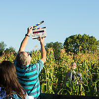 Mo Rocca on set in a corn field filming CBS Saturday morning's The Henry Ford's Innovation Nation.  Photographed by set photographer Kristina Sikora
