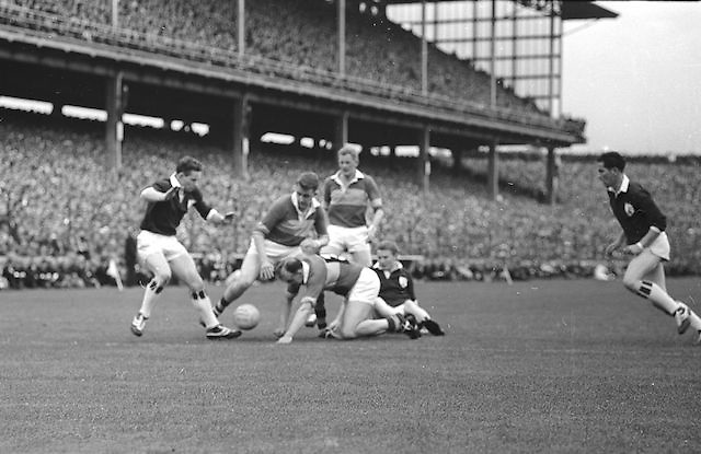 N. Sheehy captain of the Kerry Team looses the ball to a Galway forward during the All Ireland Senior Gaelic Football Championship Final, Kerry vs Galway in Croke Park on the 27th September 1964. Galway 0-15 Kerry 0-10.