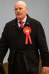 Maidenhead, UK. 13 December, 2019. Pat McDonald (Labour) observes proceedings at the general election count for the Maidenhead constituency.