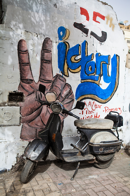 Victory sign that is part of a graffiti mural near Tahrir Square supporting the revolution.