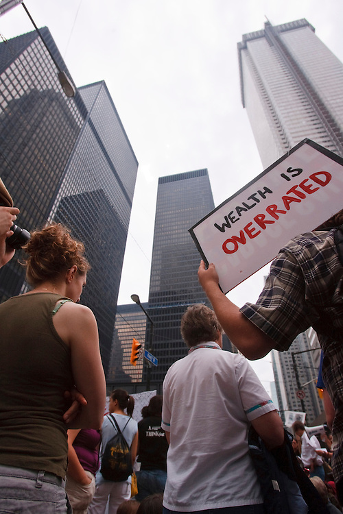 A Protestor holds a sign during a peaceful protest in the financial district of Toronto, Canada during the final day of the G20 summit June 27, 2010.AFP/GEOFF ROBINS/STR