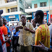 Bitter arguments erupt in central Monrovia following the announcement of Charles Taylor's guilty verdict. Monrovia, Liberia, April 2012.