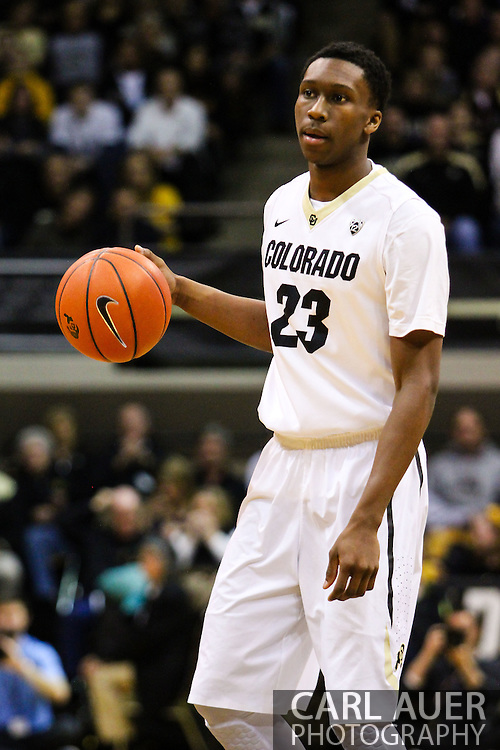 February 9th, 2014:  Colorado Buffaloes freshman guard Jaron Hopkins (23) handles the ball in the first half of the NCAA Basketball game between the Washington Huskies and the University of Colorado Buffaloes at the Coors Events Center in Boulder, Colorado