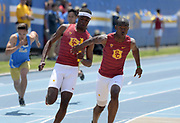 T.J. Brock takes the handoff from Rai Benjamin on the Southern California 4 x 400m relay that won in 38.89 during a collegiate dual meet against UCLA at Drake Stadium in Los Angeles, Sunday, April 29, 2018.