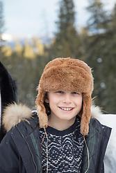 little boy in a fun Winter cat