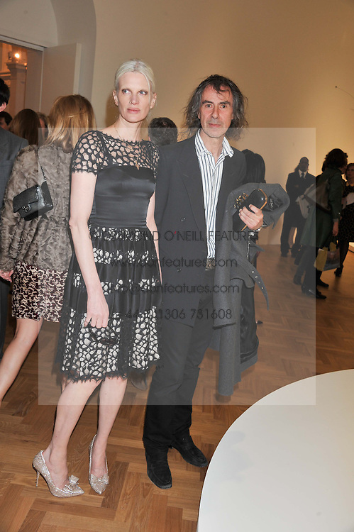 IVOR BRAKA and KRISTEN McMENAMY at a Private View of 'Calder - After The War' at Pace London, Burlington Gardens, London on 18th April 2013.