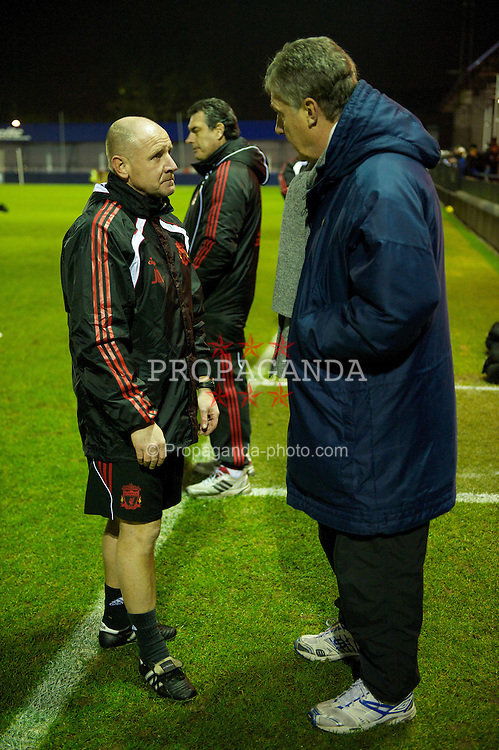 MANCHESTER, ENGLAND - Wednesday, January 19, 2011: Liverpool's reserve team manager John McMahon chats with Manchester City assistant manager Brian Kidd during the Lancashire Senior Cup Quarter-Final match at Ewen Fields. (Photo by David Rawcliffe/Propaganda)