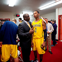 BLOOMINGTON, IN -- February 3, 2013 -- University of Michigan forward Glenn Robinson III is consoled by Assistant Coach Bacari Alexander in the lockerroom after losing to the Indiana University Hoosiers.  (PHOTO / CHIP LITHERLAND)