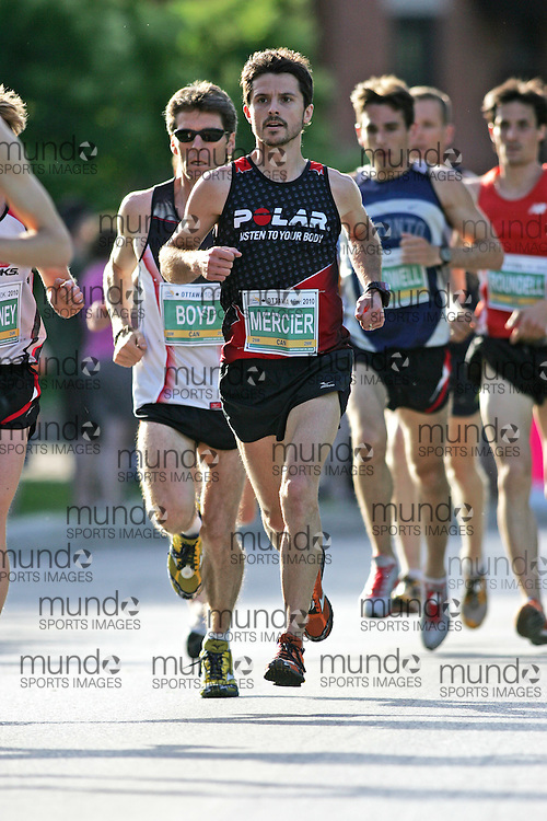 (Ottawa, ON --- May 29, 2010) RUDY MERCIER running in the 10km race during the Ottawa Race Weekend. Photograph copyright Sean Burges / Mundo Sport Images