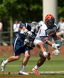 Virginia Cavaliers D Chad Gaudet (7) wins a faceoff from Villanova Wildcats Midfield T.J. O'Donnell (14).  The #5 ranked Virginia Cavaliers defeated the #19 ranked Villanova Wildcats 18-6 in the first round of the 2008 NCAA Men's Lacrosse Tournament the University of Virginia's Klockner Stadium in Charlottesville, VA on May 10, 2009.
