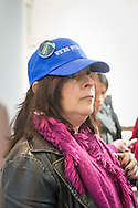 "Melville, New York, USA. 24th January 2017. ANDREA ROSS BOYLE, of Dix Hills, is wearing a ""WE'RE STILL HERE"" blue cap with large button that has picture of Statue of Liberty and says ""WOMEN'S MARCH in New York City, January 21, 2017"" on it. She's one of 15 members of Together We Will Long Island that stopped by to visit Melville office of U.S. Senator Chuck Schumer of New York, to share their concerns, especially about Trump's Cabinet appointees, #SwampCabinet. This Stop Trump Tuesday, #StopTrumpTuesday, event was part of nationwide political movement.  Members of organizations such as MoveOn, Indivisible, and TWW plan to visit their Senators' offices each Tuesday duringTrump's first 100 days of presidency."
