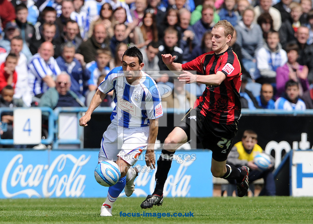 Huddersfield- Saturday May 15th, 2010: Gary Roberts of Huddersfield Town looks to evade Marc Laird of Millwall during the Coca-Cola Championship Playoff Semi Final 2nd leg match at The Galpharm Stadium, Huddersfield. (Pic by Andrew Stunell/Focus Images)..