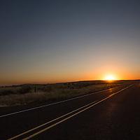 Sun sets on the freeway near Condon, Oregon