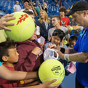 August 20, 2014, New Haven, CT:<br /> Jim Courier signs autographs during the Men's Legends Event on day six of the 2014 Connecticut Open at the Yale University Tennis Center in New Haven, Connecticut Wednesday, August 20, 2014.<br /> (Photo by Billie Weiss/Connecticut Open)