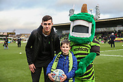 Mascot with Forest Green Rovers Taylor Allen(12) during the EFL Sky Bet League 2 match between Forest Green Rovers and Scunthorpe United at the New Lawn, Forest Green, United Kingdom on 7 December 2019.