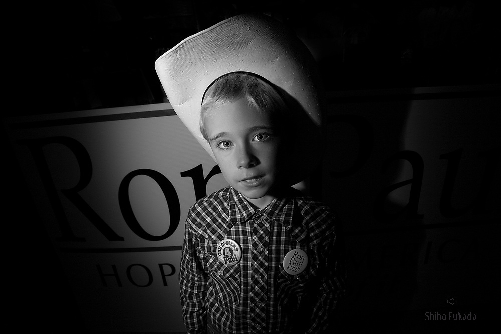 Robbie Robertson, 8, attends  U.S. Republican Presidential candidate Ron Paul's speech during his campaign stop, October 27, 2007 in Des Moines, Iowa.