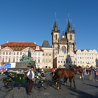 EN&gt; A horse cart and its proud driver at Prague's Old Town Square | <br />
