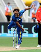 Lasith Malinga bowls for Sri Lanka during the ICC Cricket World Cup match between Afghanistan and Sri Lanka at university oval in Dunedin, New Zealand. Photo: Richard Hood/photosport.co.nz