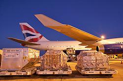 Cargo being taken to a British Airways plane for departure from Houston's Intercontinental Airport