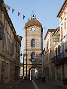 Early morning departures for pilgrims to Santiago de Compostela takes them under the Western gate of the town of Auvillar.