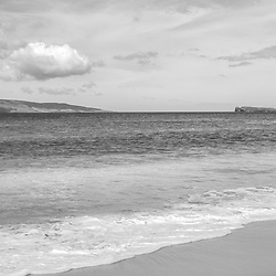 Big Beach Maui Hawaii black and white panorama photo with Molokini Crater and Kaho'olawe Island Reserve. Big Beach is in Wailea-Makena Hawaii and is one of Maui's most popular beaches. Panoramic photo ratio is 1:3. Copyright ⓒ 2019 Paul Velgos with All Rights Reserved.